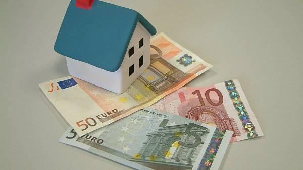 Themenbild: Haus und Geldscheine