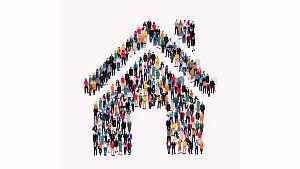 Symbol eines Hauses, das aus vielen Menschen besteht