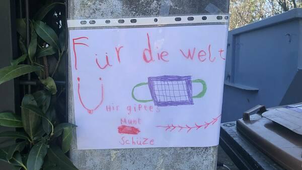 Themenbild: Aushang, Kinder werben für Mundschutz