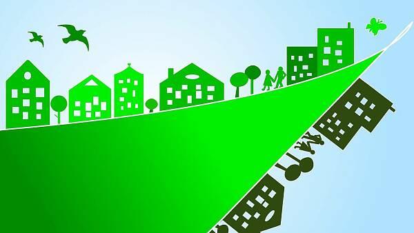 Themenbild: Zeichnung mit grünen Häusern, Vögeln und Schmetterlingen
