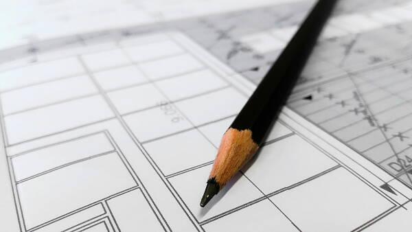 Themenbild: Bleistift mit Grundriss